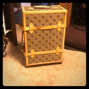 Dooney & Bourke luggage.